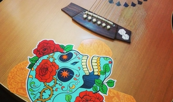 #Sugarskull #sticker on Cole Clarke #acoustic #guitar